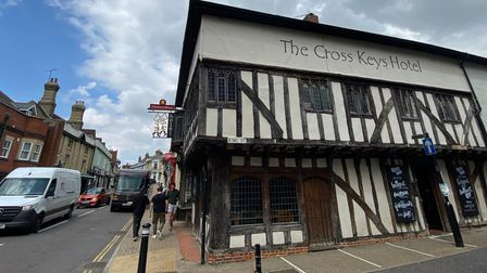 An old Essex pub with beams: The Cross Keys Hotel. The sky is blue.