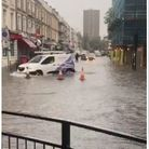 Floods in Maida Vale (centre/left) and drenched belongings (right)