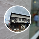 """A montage: The Cross Keys in Saffron Walden superimposed over a signpost: """"Restricted Width"""""""