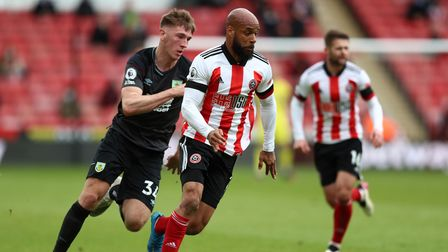 Sheffield United's David McGoldrick and Burnley's Jimmy Dunne (left) battle for the ball during the