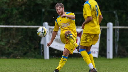 Sam Ruff of Harpenden Town plays a pass forward in the match between Harpenden Town and London Colne