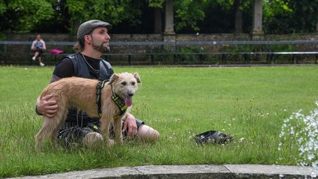 Alexander with his dog Rosie enjoying the fountains at Waterloo Park in Norwich. Picture: Danielle B