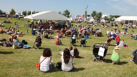 Relaxing in the sunshine and watching the bandstand entertainment