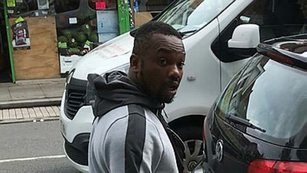 Police wish to speak to this man after a pedestrian was punched and robbed in Ilford