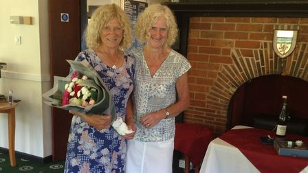 Lady Captain Mo Kendall being presented with thank-you bouquet by Mo Borer