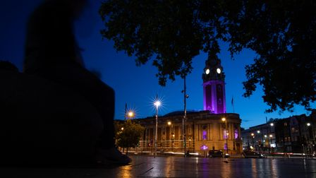 Lambeth Town Hall in Brixton, south London, is lit up in purple to honour George Floyd who was kille