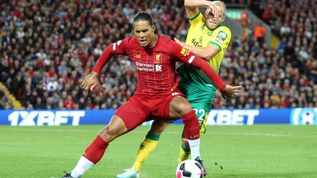 Virgil van Dijk of Liverpool and Teemu Pukki of Norwich in action during the Premier League match at