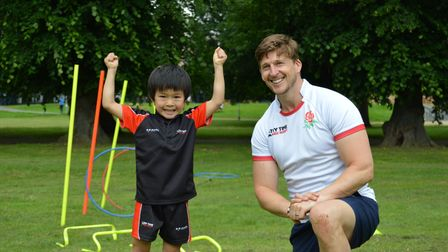 David Strettle with one of the excited children at Try Time Kids' Rugby in Harpenden