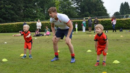 David Strettle coaches the excited children at Try Time Kids' Rugby in Harpenden