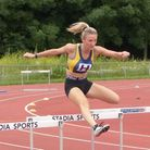 Flic Clarke on her way to 400m hurdles victory