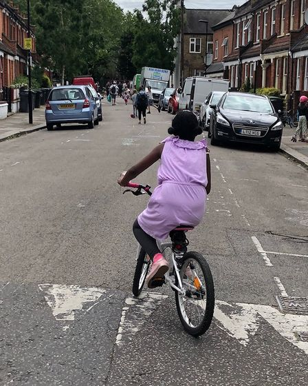 Young girl cycling in Islington