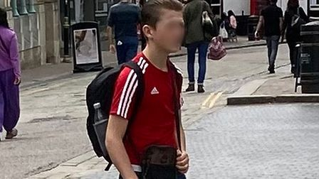 Watch out for this teenager - he's scamming shoppers with a false boxing club claim.