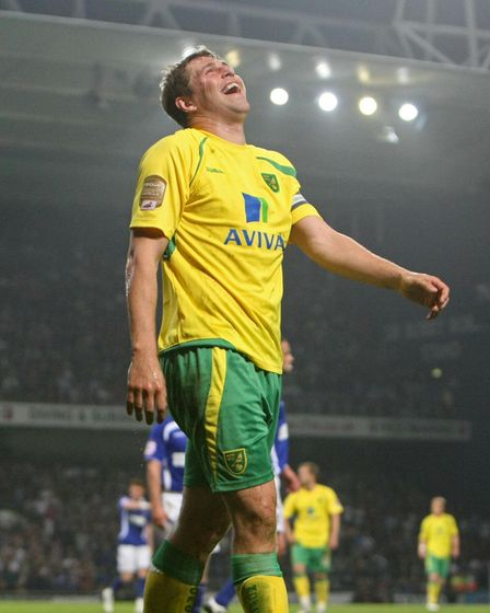 Grant Holt of Norwich has a laugh at Ipswich