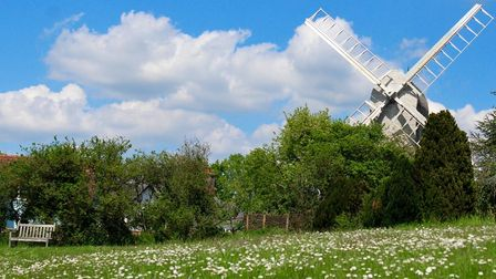 The wooden windmill in Finchingfield against a blue sky.