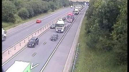 Traffic camera footage of the M11 near Essex. The road is busy