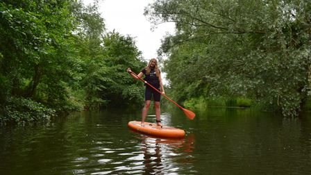 EDP reporter Emily Thomson paddleboarding on theRiver Wensum with Norwich Paddleboard Hire.