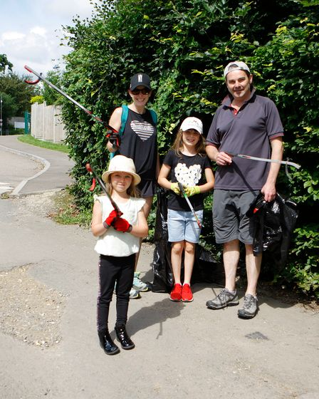 The Smith family at the @BambuuBrush and Blueharts Hockey Club litter pick at Lucas Lane Sports Club, Hitchin