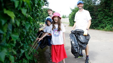 The Bramall family litter picking near Lucas Lane in Hitchin, where @BambuuBrushsaid there were endless amounts of rubbish