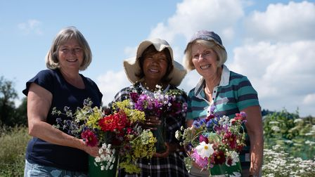 The self named 'Flower Girls' Jane, June and Ann farm members who oversee the gardens, grow a wide r