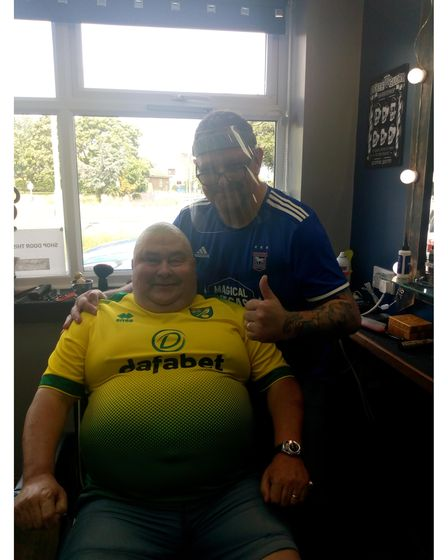 Julian Willimott after the special head and face shave for charity with proprietor Bob Brooks.