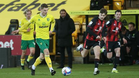 Jacob Sorensen of Norwich and David Brooks of Bournemouth in action during the Sky Bet Championship