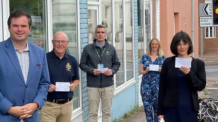 MP Kevin Foster handed cheques to representatives of the four good causes