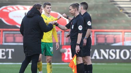 Norwich Head Coach Daniel Farke and Jacob Sorensen of Norwich with the officials at the end of the S