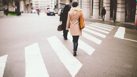 Man and woman crossing the road