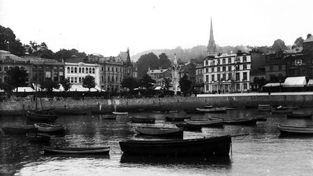 View of the inner harbour with Williams & Cox, the Clock Tower and The Queen's Family Hotel