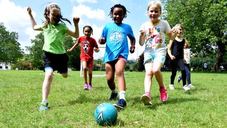 Year 2 children compete in a football match