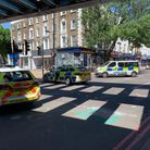 Police cars attend the site in Camden Road.