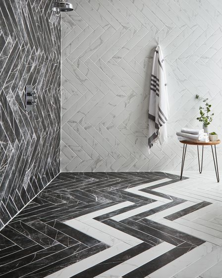 Turning your bathroom into a wet room will make it easier to manoeuvre a wheelchair. wallsandfloors.co.uk