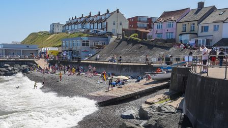 Locals and tourists enjoying the sunshine on Sheringham beach. Picture: Danielle Booden