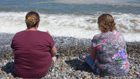 Two ladies enoying sitting on Sheringham beach. Picture: Danielle Booden