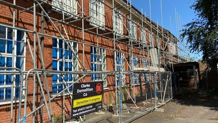 Former Deben High main school building shrouded in scaffolding - 90% of materials will be recycled