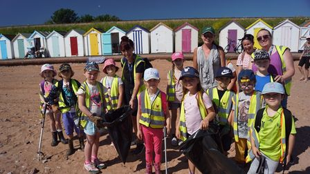 Youngsters fromCurledge Street Academy picking up plastic and litter from the beach.