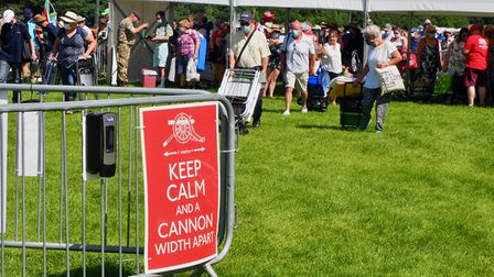 A poster advising social distancing at the Battle Proms concert in Hatfield Park.