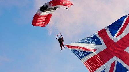 The Red Devils parachute display team dropping in on the Hatfield House Battle Proms concert.