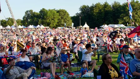 Crowds of people at the 2021 Battle Proms concert in the grounds of Hatfield House, Hertfordshire.