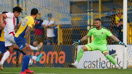 Michael Johnson of St Albans City covers his near post