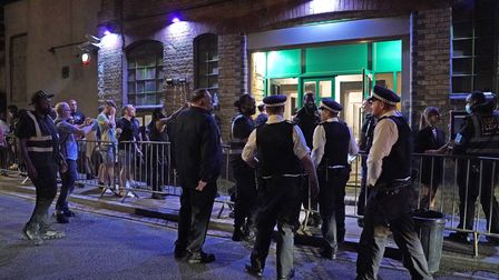Police talk to security as people queue up for the Egg nightclub in London, after the final legal co