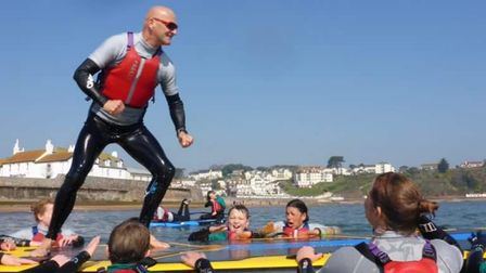 Chris Leaman with youngsters at The Wave Project in Goodrington