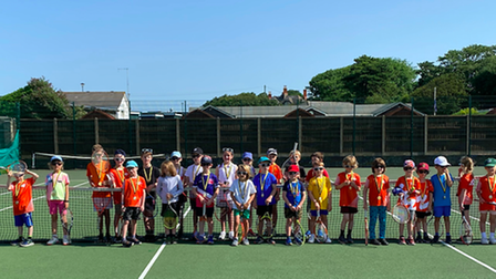 Junior players face the camera at North Somerset Tennis Academy