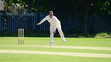 Paul Humphries in bowling action for Hornchurch Athletic at Newham
