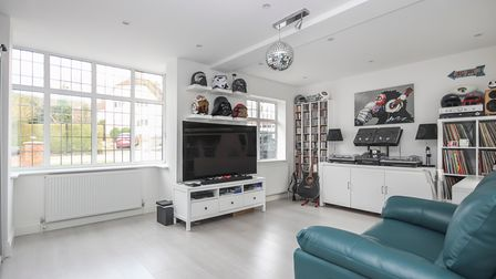 The bright family room overlooks the drive.