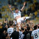 Argentina players throw Lionel Messi in the air after beating Brazil in the Copa America final