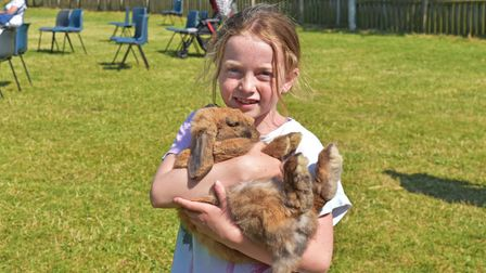 Evelyn-Jo Mills with her rabbit 'Lickety' at the special outdoor Pets Service on Sunday.