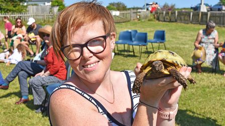 Sarah Pastre with her five-year-oldtortoise 'Alan'as the special outdoor Pets Service on Sunday.