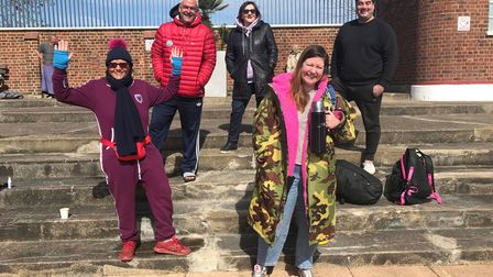 The Parliament Hill Lido swimmers pose ahead of their cold water challenge across the Channel