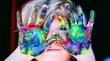 Child with rainbow painted hands